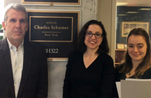 Hunter O'Hanlan, the executive director of the College Art Association, with Kathleen Fitzpatrick, associate executive director of the MLA, in front of Senator Charles Schumer's office with Senator Schumer's legislative aide, Morgan Brand.